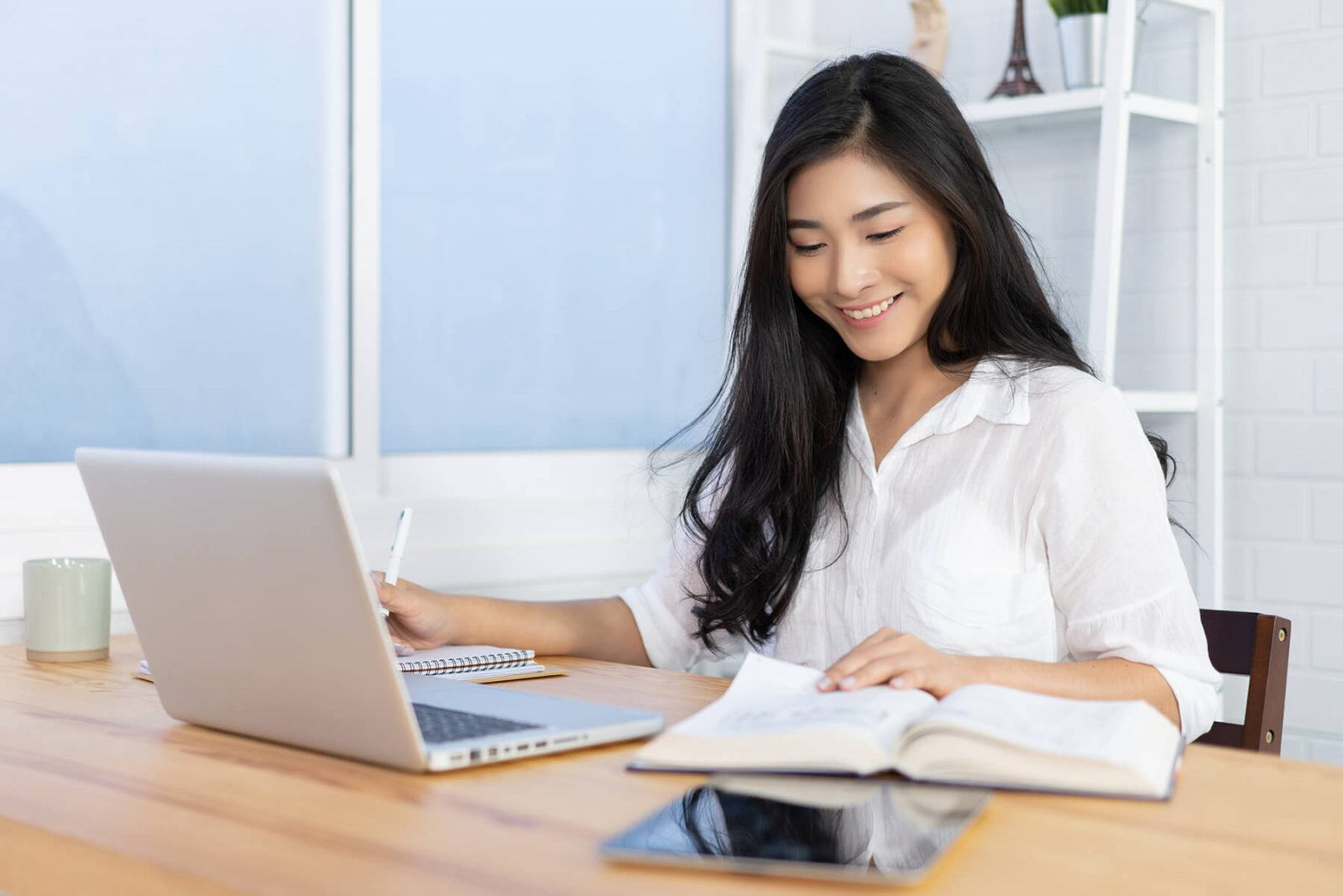 female student learning at home