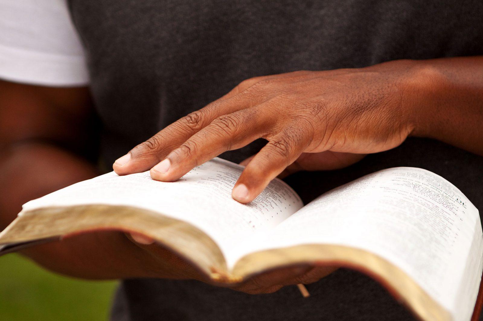 man-skimming-bible