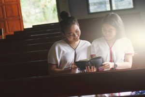 Two students reading the bible together Global University Correspondence Learning