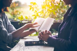 Two women studying the Bible together